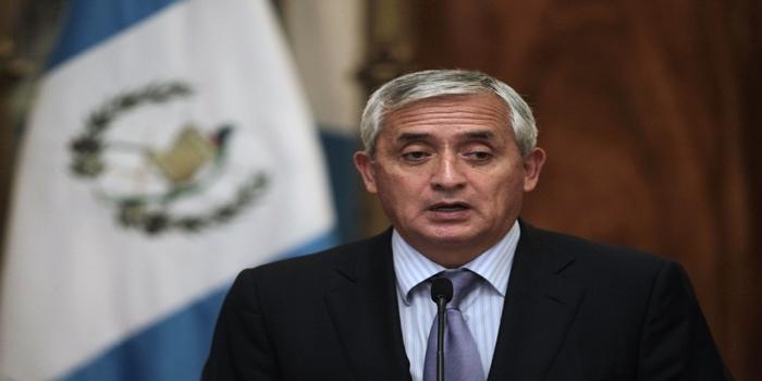 Guatemalan President Perez Molina speaks with the media in Guatemala City
