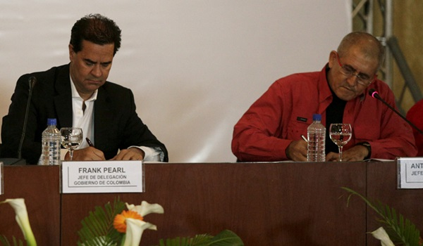 Frank Pearl, head of Colombian government delegation and Antonio Garcia, head of  National Liberation Army (ELN)  delegation, sign a joint statement to begin formal peace talks in Caracas