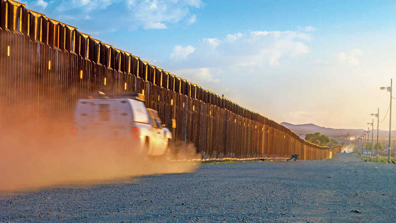 Border patrol trucks driving to catch illegal alien