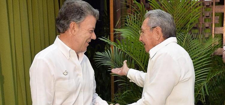Juan Manuel Santos + Raul Castro