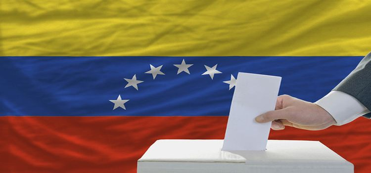 man voting on elections in venezuela in front of flag