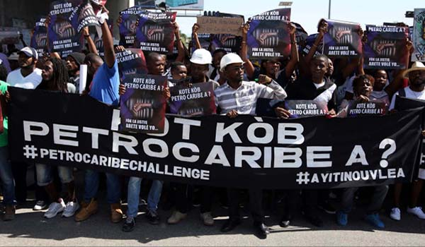 Haitians protest  to call for an investigation into the alleged misuse of Venezuela-sponsored PetroCaribe funds by previous administrations, in Port-au-Prince